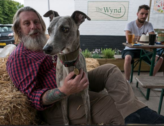 customer and dog outside Garden City Brewery